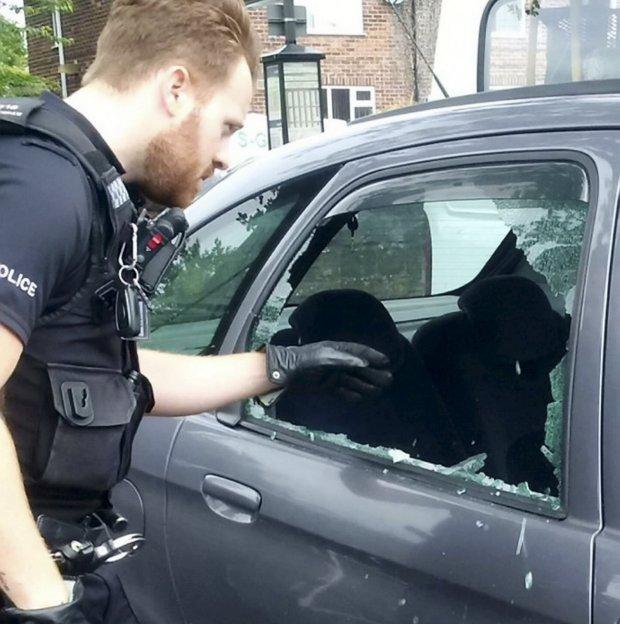 Police break window